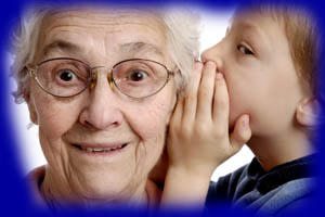 boy whispering to great-grandmother
